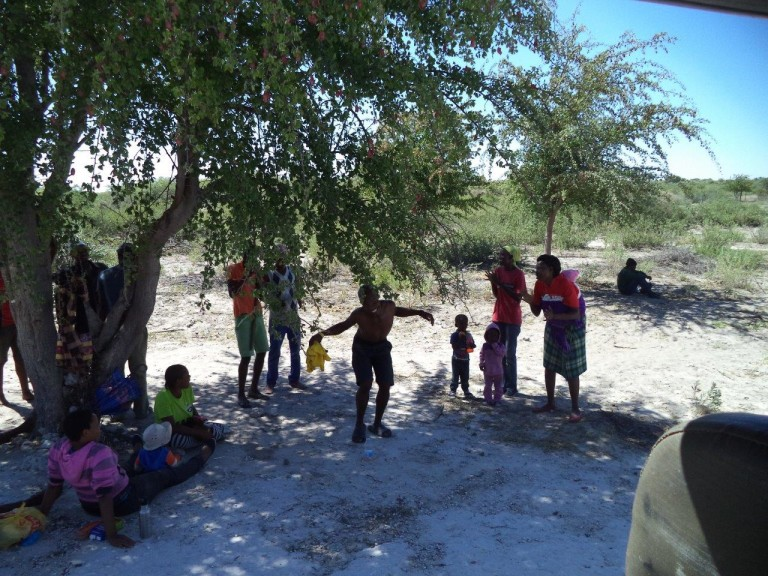 Child dancing in the shade of a tree – Okavango Expeditions