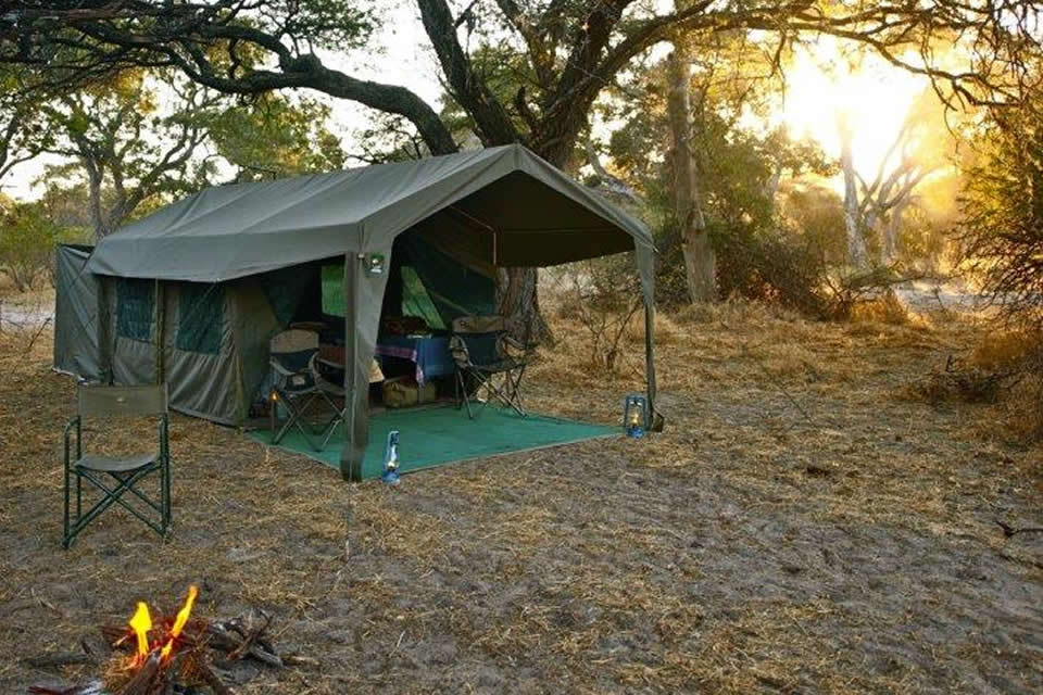 Okavango Expeditions guest tent exterior at sunset