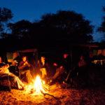 Sitting around the campfire on an Okavango Expeditions safari