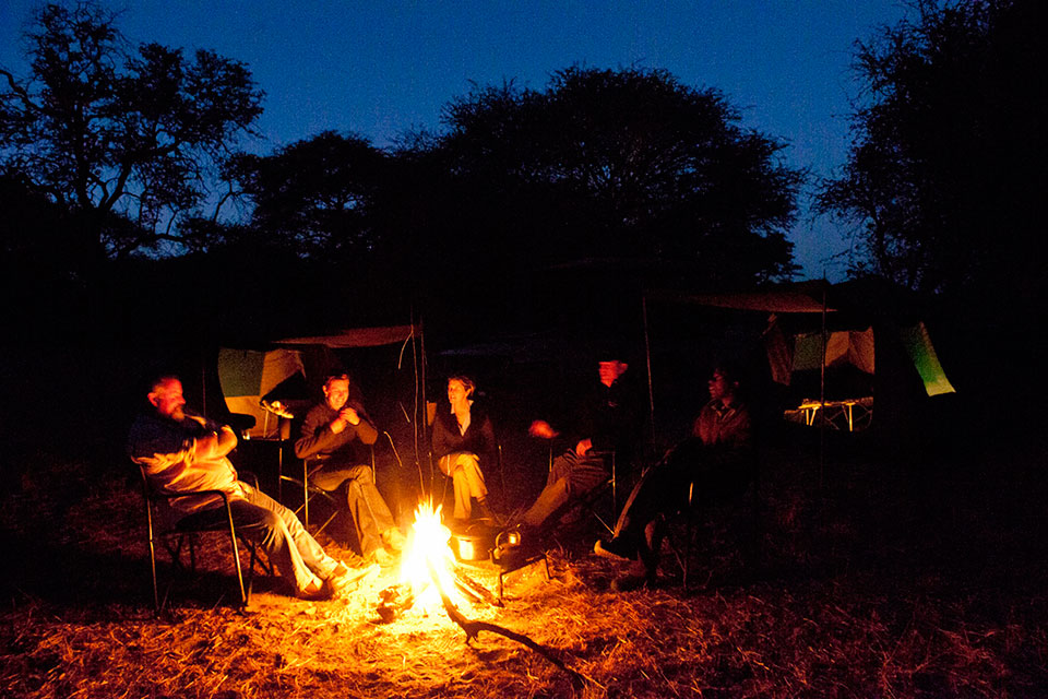 Sitting around the campfire on an Okavango Expeditions safari