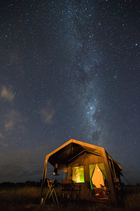 Okavango Expeditions client tent at night with the Milky Way