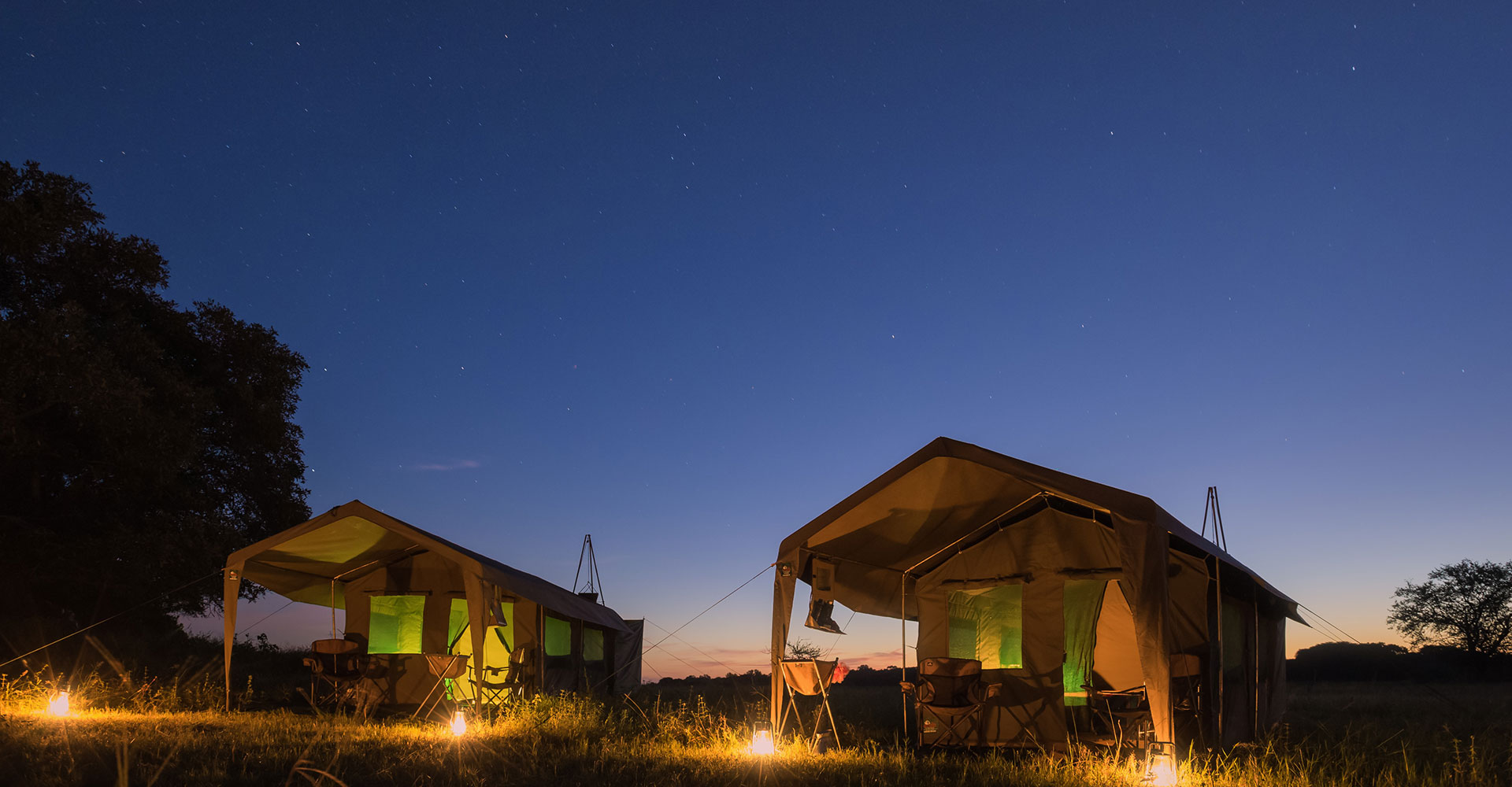 Okavango Expeditions mobile safari tents at night
