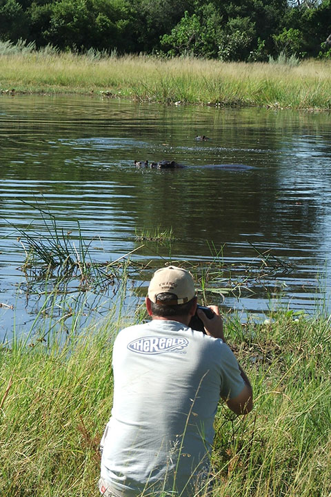 Okavango Expedition client photographing a hippo